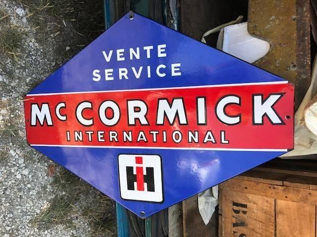 ARRIVING NOVEMBER Mc Cormick International Enamel Advertising Sign
