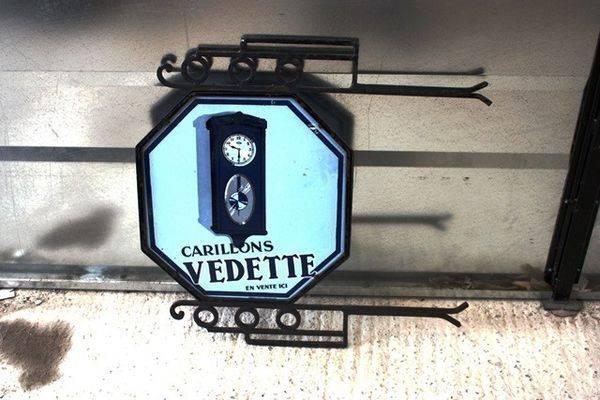 Vedette Wall Clock Double Sided Enamel Sign Arriving Nov