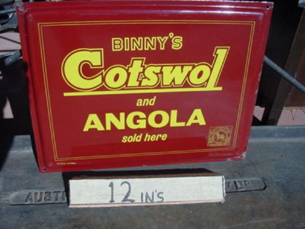 Binnys Cotswol + Angola Fabrics sold here enamel sign