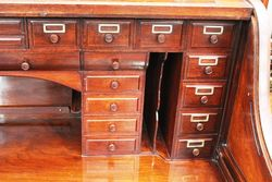 A Maple + Co Antique Roll Top Desk