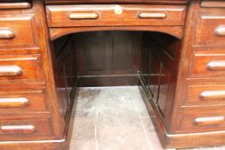 A Maple + Co Antique Roll Top Desk