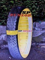 ARRIVING NOVEMBER  Dunlop Tyres Tin Advertising Sign