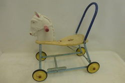 A Selection of Childrenand39s Rockers and Push Toys