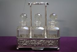 Antique Victorian Cut Glass 3 Bottle Tantalus in a Silver Plated Stand #