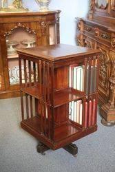 Edwardian Inlaid Mahogany Revolving Bookcase .#