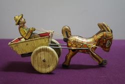 A Mark Toys Clockwork Tinplate Model Of A Donkey Pulling A Cart  #