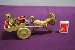A Mark Toys Clockwork Tinplate Model Of A Donkey Pulling A Cart