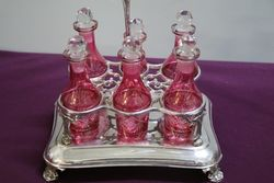 6 Bottle Ruby Cruet EPNS Stand C1910 With Later C20th Bottles