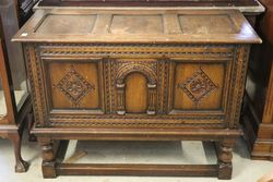 A Quality C20th English Carved Oak Coffe