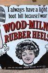 Wood Milne Rubber Heels Enamel Sign