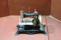 A German Casige No13 Tin Plate Miniature Sewing Machine