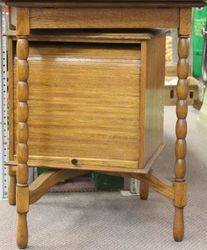 Oak Revolving Display Cabinet with Rolling Front and Back Doors